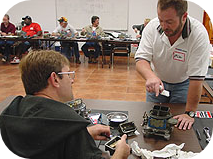 Photo of Mike Ross providing one-on-one Holley carburetor training